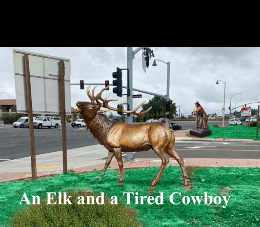 elk-and-tired-cowboy